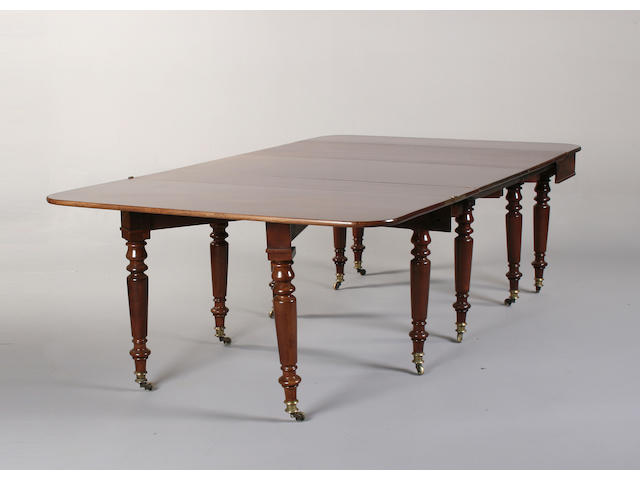 A Regency style mahogany extending concertina action dining table