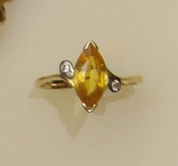 A three stone yellow sapphire and diamond ring