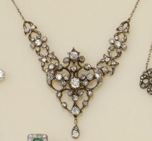 A late Victorian gold and silver mounted diamond pendant necklace
