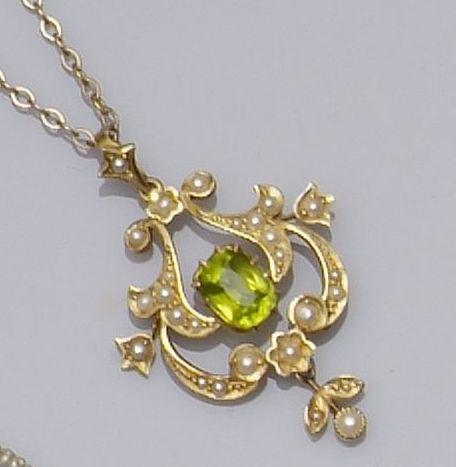 An Edwardian gold peridot and seed pearl openwork pendant