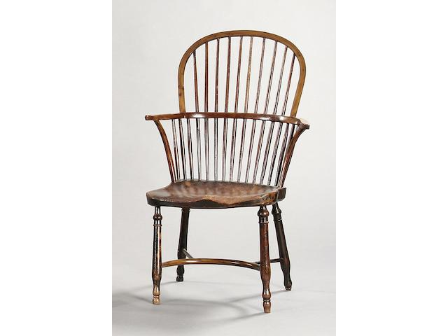 A 19th Century yew, ash and elm stick back Windsor armchair