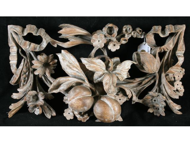 Four early 18th Century carved limewood crestings,