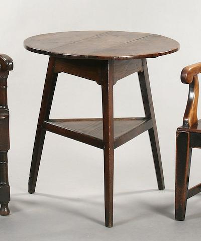 An early 19th Century oak cricket table,