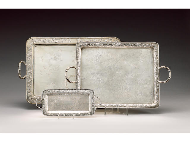 A Chinese silver two-handled rectangular tray, by Wang Hing, also with Chinese character mark,  a small Chinese silver two-handled rectangular tray, by Wang Hing, and  an electroplated two-handled rectangular tray,