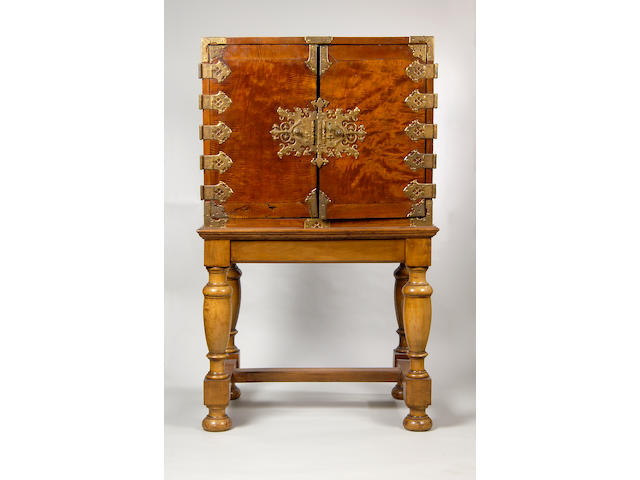 An 18th century Dutch East Indies brass mounted cabinet on later stand,