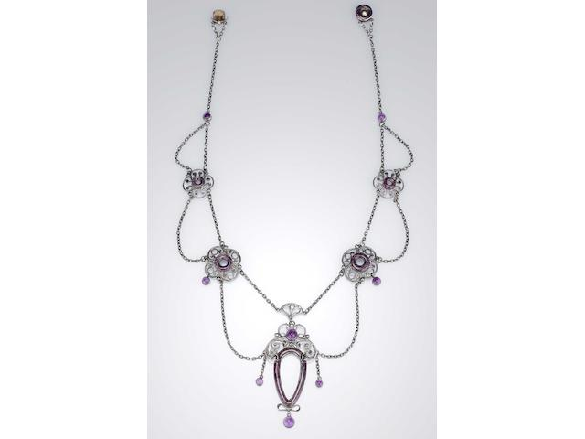 An Arts and Crafts amethyst and purple enamel necklace by The Guild of Handicrafts Unmarked, in fitted Guild of Handicrafts case,