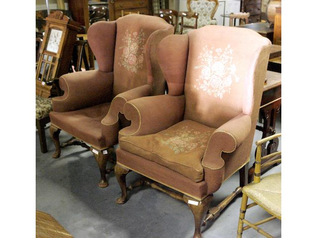 A pair of George III style mahogany wing armchairs