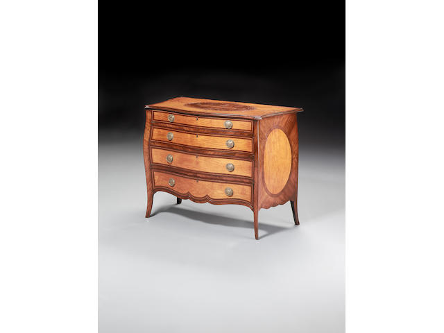 A George III satinwood, purplewood crossbanded and sycamore marquetry serpentine Commodein the manner of John Cobb