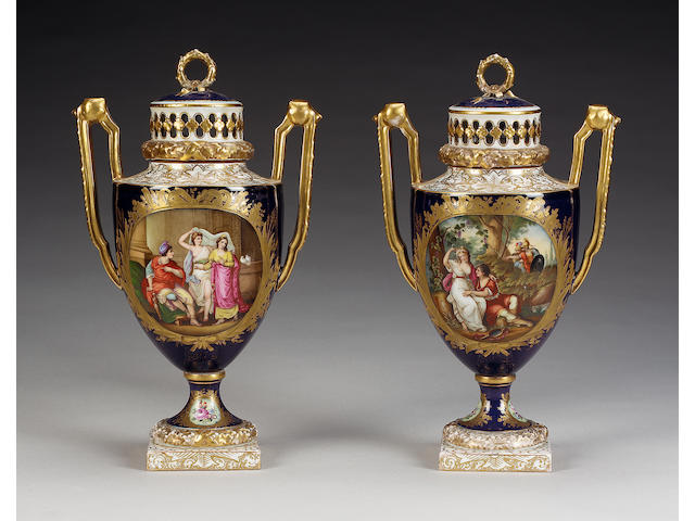 A pair of Dresden dark-blue ground pot pourri vases and covers, late 19th century,