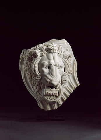 A Roman sarcophagus fragment with a lion head