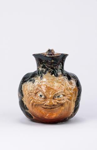 Martin Brothers A Stoneware Grotesque Face Jug, 1891