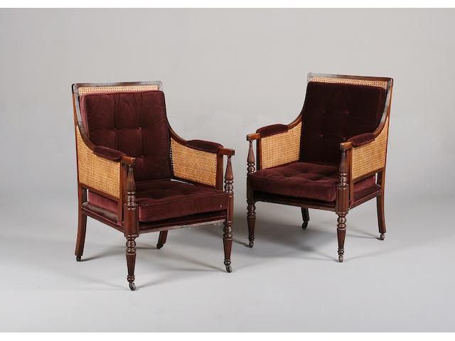 A pair of Regency mahogany framed bergères