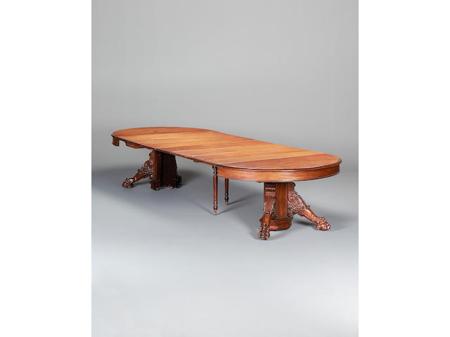 A large late 19th century mahogany split pedestal extending dining table possibly American