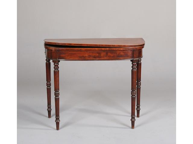 An early 19th Century mahogany 'D' shaped tea table,