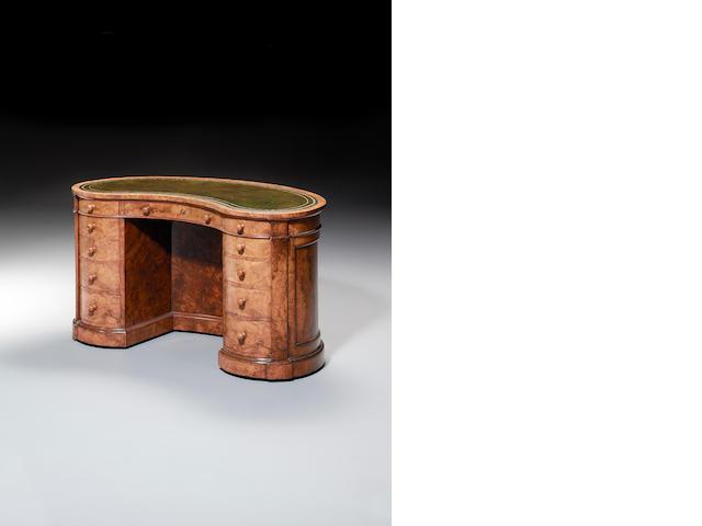 A Victorian burr walnut kidney shaped Pedestal Desk