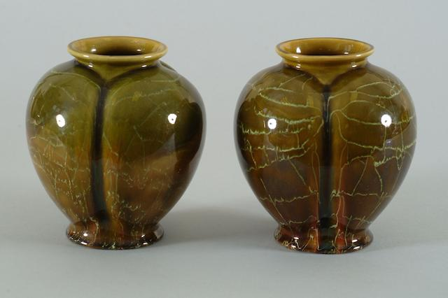 A pair of Linthorpe pottery vases