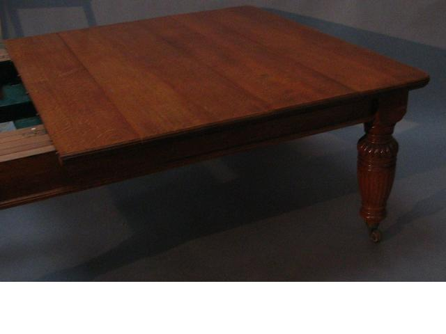 A very large Victorian oak extending dining table