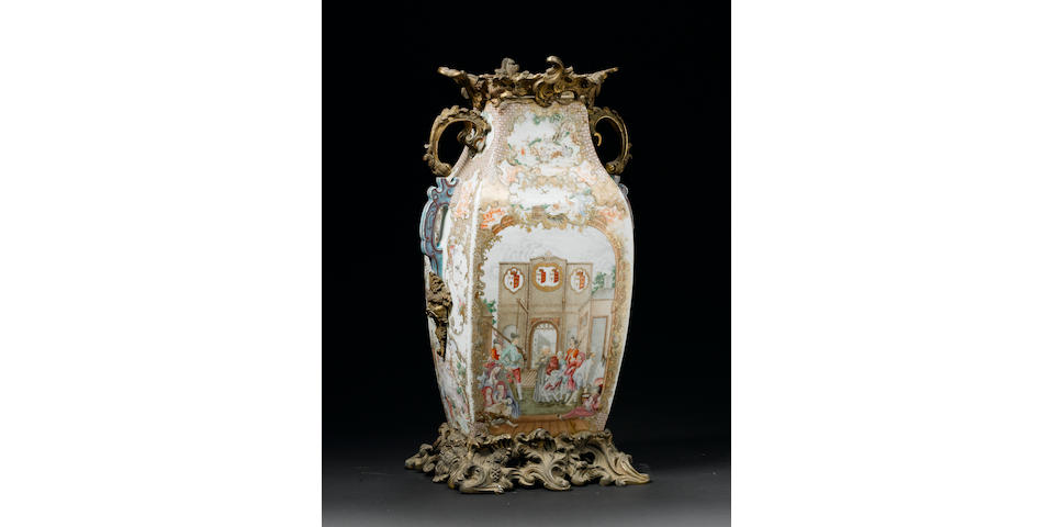 A rare and important ormolu-mounted famille rose armorial 'European subject' rectangular baluster vase The porcelain Qianlong, circa 1750-60, the mounts 18th/19th century