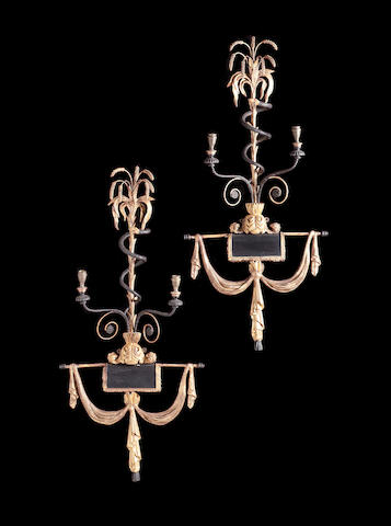 A pair of Regency carved gilt composition and ebonised twinlight Girandoles