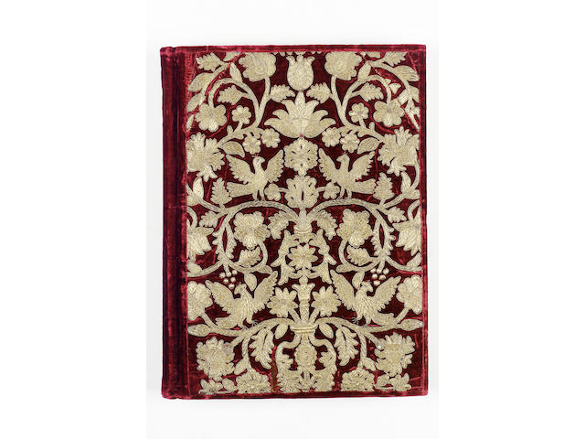 EMBROIDERED BINDING An album containing approximately 150 blank leaves, cover with a bold design of flower and foliage branching from a composite central stem, with birds perched on the branches, embroidered in gold thread on red velvet