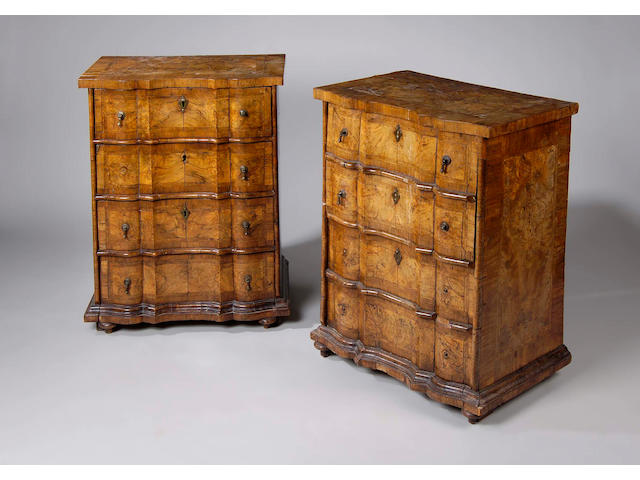 A good pair of 18th Century Italian figured walnut crossbanded and feather strung petit commodes,