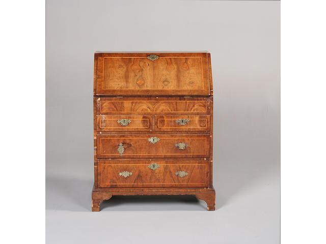 A small George II walnut bureau