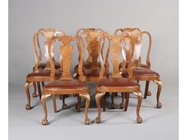 A set of eight early 20th century walnut and parcel gilt dining chairs in the George I style