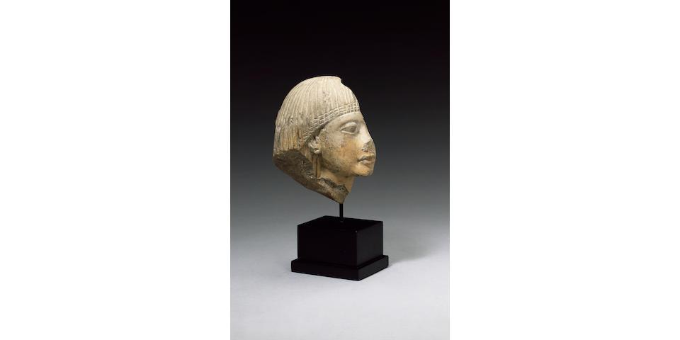 An Egyptian white limestone head fragment