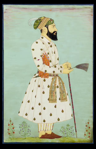 A portrait of the Mughal Emperor Aurangzeb (1618-1707) standing facing right holding a gauri and leaning on a sword Golconda, circa 1700