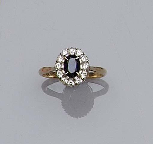 A sapphire and diamond oval cluster ring,