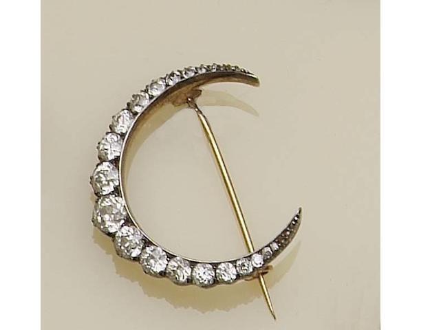 A gold and silver mounted diamond crescent brooch