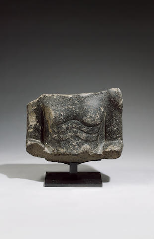 An Egyptian black granite torso fragment of a seated official
