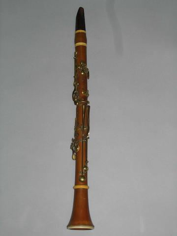 A 19th century Boxwood and ivory Clarinet