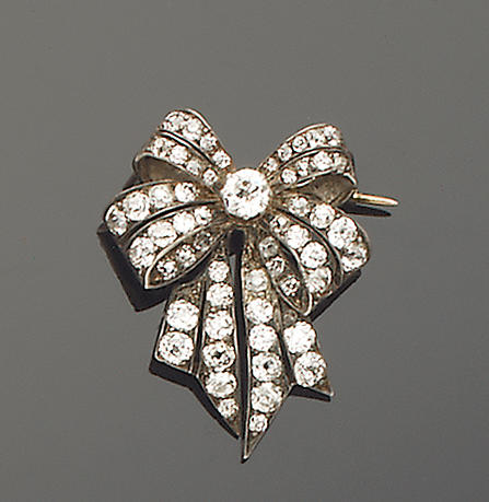 A bow brooch set with old brilliant-cut diamonds