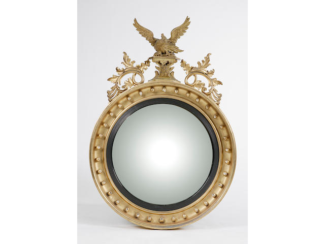 A Regency carved giltwood convex mirror