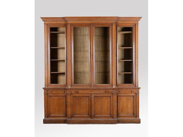 A large Victorian oak breakfront bookcase cabinet