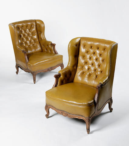 A pair of late 19th century carved oak library chairs