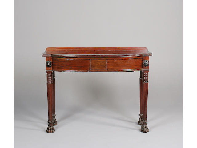 A mahogany bow front serving table