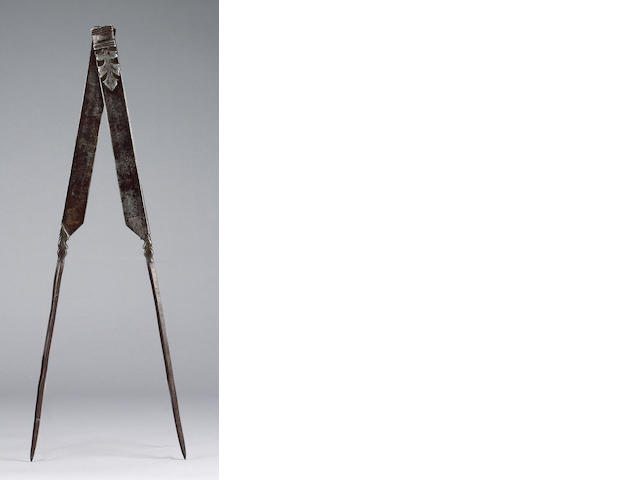 A large pair of mason's iron dividers,  European,  17th century,