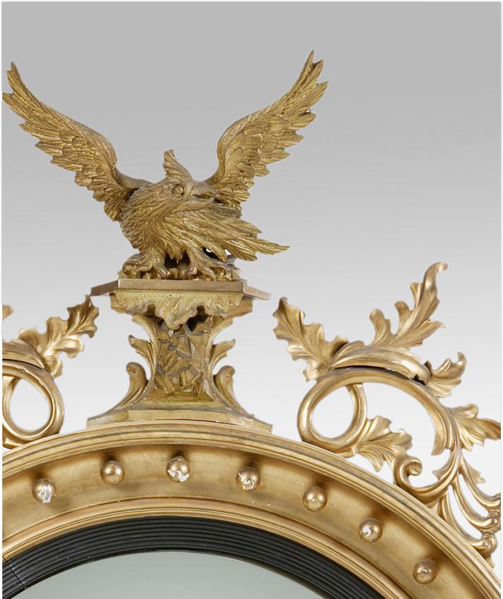 A Regency carved giltwood convex mirror
