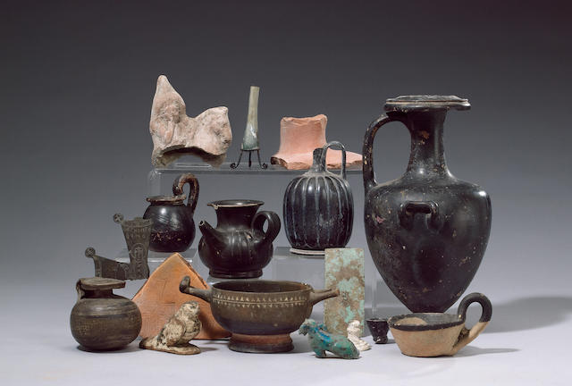 A quantity of mainly South Italian black ware vessels, several Egyptian antiquities and a terracotta