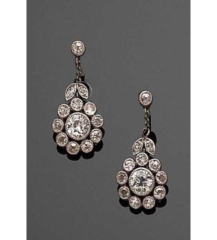 A pair of diamond cluster earpendants