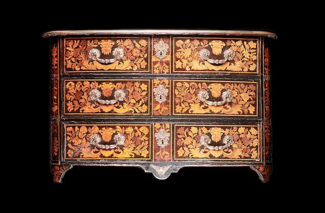 A Régence ebonised, sycamore, walnut and kingwood crossbanded floral marquetry Commode en arbalète in the manner of Auburtin Gaudron