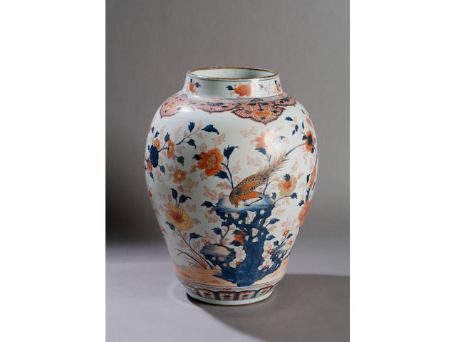 A large Chinese Imari baluster vase Early 18th Century, painted with flowers and exotic birds in underglaze blue and rust with gilt heightening, 48cm high.