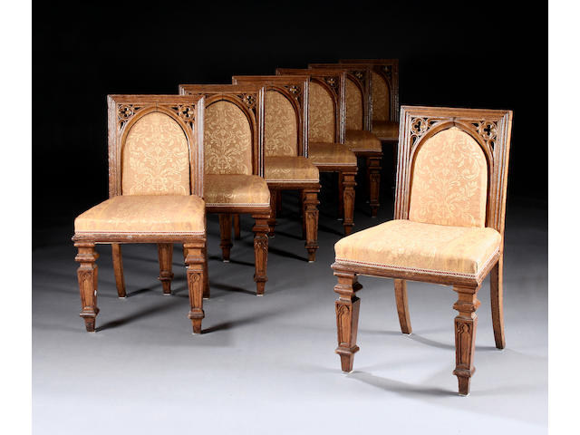 A set of seven 19th century gothic revival oak dining chairs