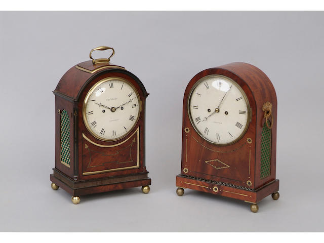 A late George III mahogany bracket clock Charles Haley, London, striking on a bell, the arched backplate with engraved border, having an enamelled circular dial, the case with arch top and shaped brass edged and strung panel beneath the dial, on ball feet, 46cm high.
