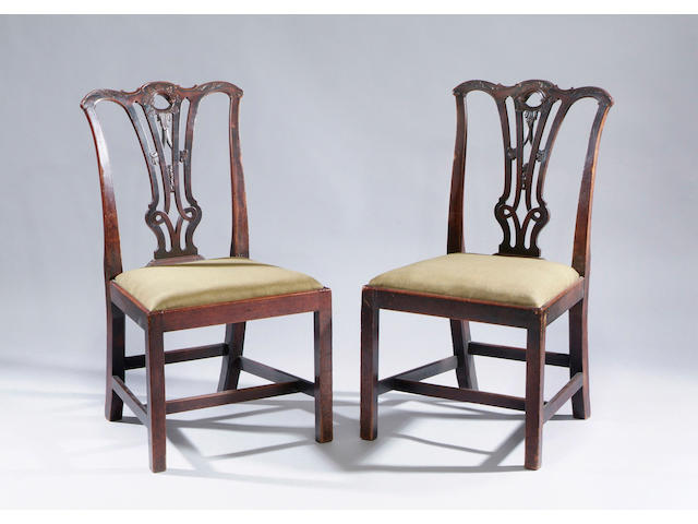 A set of six George III mahogany dining chairs With pierced splats and drop-in seats, on square frames and two Victorian open armchairs of similar style. (8)