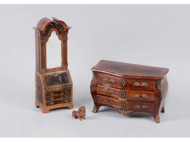 A Louis XVI kingwood parquetry miniature commode Of bombe outline, fitted with three drawers with rococo gilt metal handles and key plates and with gilt metal angle mounts and sabots, 30cm.