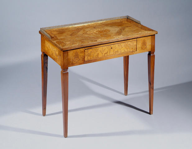 An Italian walnut and marquetry side table The top with three quarter pierced brass gallery and inlaid with a small coat of arms and central panel of a woodman in a forest, fitted with a frieze drawer on tapered legs, 101cm wide.