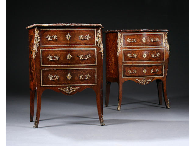 A good pair of late 19th century marble-topped rosewood, kingwood and marquetry serpentine commode chests